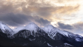 Mountain peaks with dramatic clouds and sky Stock Photography