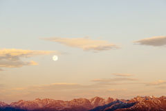 Mountain peaks with full moon Royalty Free Stock Image