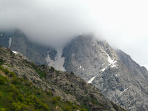 Mountain peaks hiding in the clouds Royalty Free Stock Photography