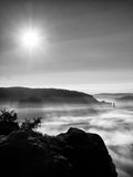 Mountain peaks increased from colorful fog in valley, fall daybreak Stock Photography