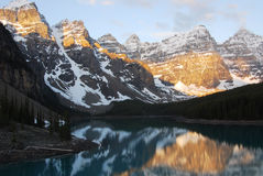 Mountain peaks and lake Stock Images