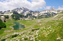 Mountain peaks with lake Stock Photos