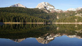 Mountain peaks mirror reflection Stock Image