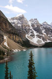 Mountain peaks and moraine lake royalty free stock photo