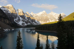 Mountain peaks and moraine lake Stock Image