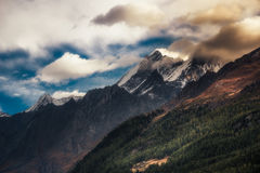 Mountain peaks. Mountainside with peaks shrouded in cloud Stock Photo