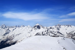 Mountain peaks and off-piste slope for freeriding in sun winter. Day. Caucasus Mountains, region Dombay Stock Photo