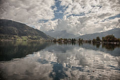 Mountain peaks, puffy clouds and Zeller lake views from Zell am See, Austria Stock Photos