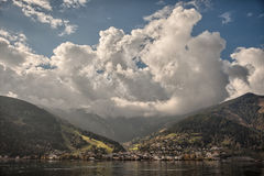 Mountain peaks, puffy clouds and Zeller lake views from Zell am See, Austria Royalty Free Stock Photography