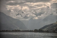 Mountain peaks, puffy clouds and Zeller lake views from Zell am See, Austria Royalty Free Stock Photo