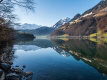 Mountain peaks reflecting in lake Royalty Free Stock Photo