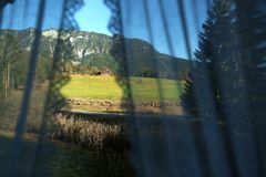 Mountain peaks seen through the curtains of my window