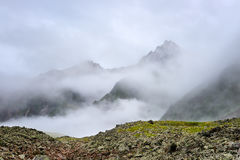 Mountain peaks shrouded cold mist Royalty Free Stock Photo