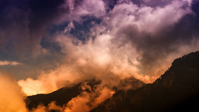 Mountain peaks. Sky and cloud covered mountain peaks Stock Images