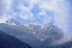 Mountain peaks. Sky and clouds above the mountain peaks Stock Image