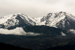 2 mountain peaks. 2 snow peaks, mountain around doksa lake, greece Stock Photography