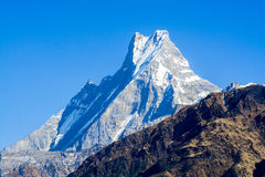 Mountain peaks with snow on blue sky background Stock Images