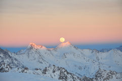 Mountain peaks in the snow. Snow-capped mountain peaks lit by the sun Stock Photos