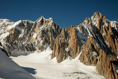 Mountain peaks, snow and glaciers near Mont Blanc, Italian side Stock Image