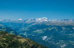 Mountain peaks with snow. There's still a bit of snow on the mountain peaks in the background. This is what I think Switzerland is Royalty Free Stock Images
