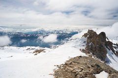 Mountain peaks and snowcapped ridges in the Alps Stock Photo