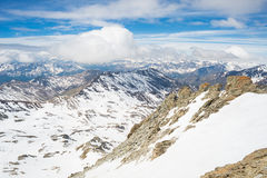 Mountain peaks and snowcapped ridges in the Alps Royalty Free Stock Photography