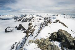 Mountain peaks and snowcapped ridges in the Alps Stock Images
