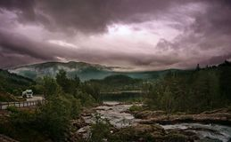 Mountain peaks and storm clouds and road in mountain, Norway royalty free stock photos
