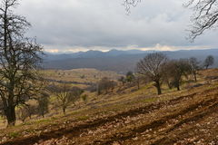 Mountain peaks before storm and muddy road. View of the Apuseni mountains from Capus village near Cluj-Napoca city, Transylvania, Romania, Europe Royalty Free Stock Images