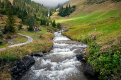 Mountain peaks, streams and meadows in Grindelwald, Switzerland Stock Photos
