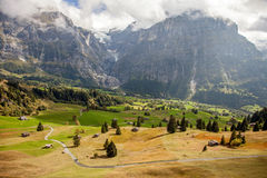 Mountain peaks, streams and meadows in Grindelwald, Switzerland Stock Photo