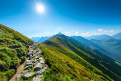Mountain peaks on a sunny morning. And a close-up trail stock images