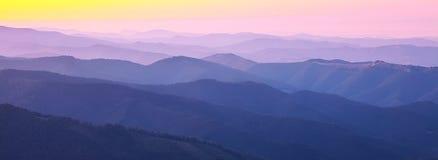 Mountain peaks at sunset haze Stock Photography