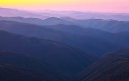Mountain peaks at sunset haze Stock Photos