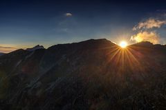 Mountain peaks at sunset Stock Photos