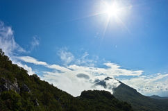 Mountain peaks of Suva Planina at morning covered with clouds Stock Image