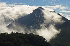 Mountain peaks of Suva Planina at morning covered with clouds Royalty Free Stock Photos
