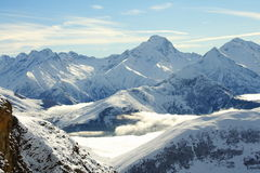 Mountain peaks in winter Stock Image