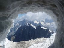 Mountain peek 2. The photo is taken through a hole in the ice Royalty Free Stock Photos