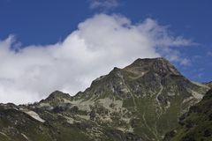 Mountain peek with clouds Royalty Free Stock Photo