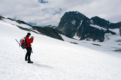 Mountain photographer on glacier Stock Photography