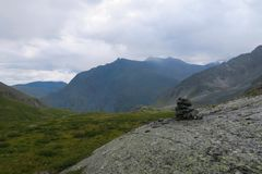 Mountain pile of stones cairn scenic view. Altai Mountains, Russia stock photography