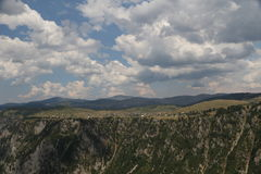 Mountain Piva. Montenegro Durmitor mountain. Panoramic view to Piva mountain with rain cloud in background Royalty Free Stock Photography