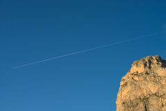 Mountain and plane trail Royalty Free Stock Images