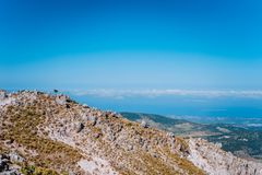 Mountain plateau, quaint stone formations and clouds scenery on the horizon. Rocky highland on Kefalonia Island, Greece.  royalty free stock images