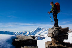Mountain pleasure. Young man in the mountains enjoying the view Stock Photo