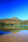 Mountain and pond in autumn Stock Image