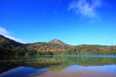 Mountain and pond in autumn Stock Photography