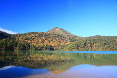 Mountain and pond in autumn Royalty Free Stock Image