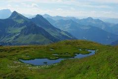 Mountain pond with a view, Austria. Mountain pond with a view near Furkajoch, Austria Royalty Free Stock Photos